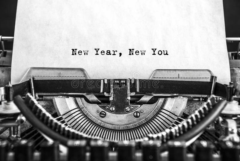 New Year New You message typed on a vintage typewriter. New Year New message written on a manual typewriter. congratulations on the holiday royalty free stock photos
