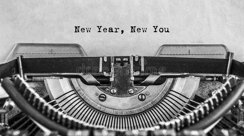 New Year New You on old vintage typewriter. New Year New You message typed on old vintage typewriter. Cloce up stock photo