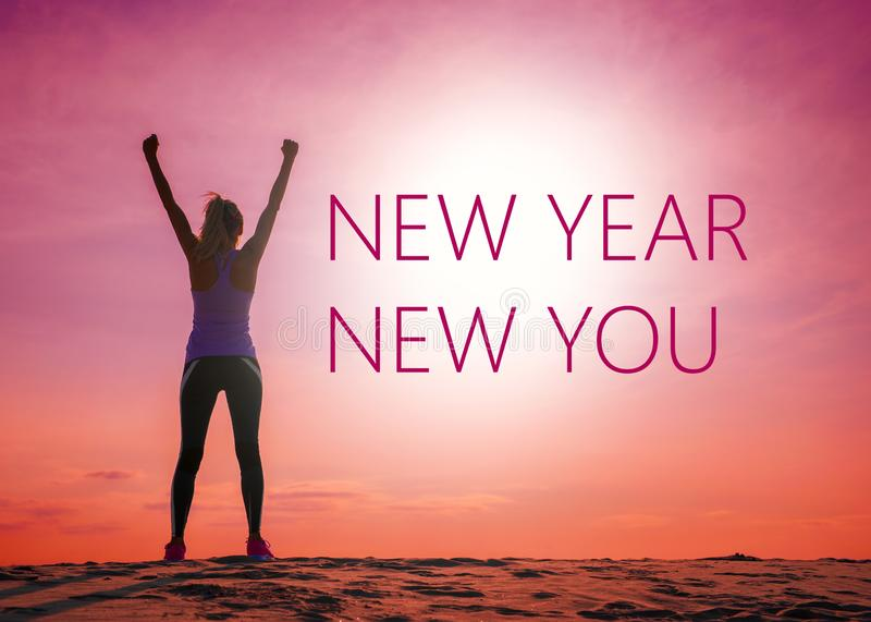 New year new you text quote on the image of womans silhouette at sunrise stock image