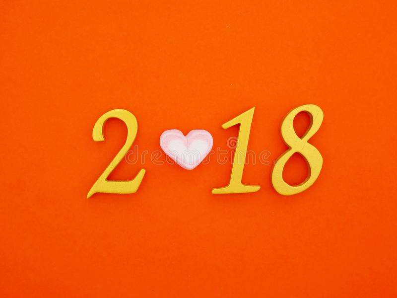 New Year 2018 Banner. A new year 2018 number in gold with pink marshmallow on bright orange paper background royalty free stock images