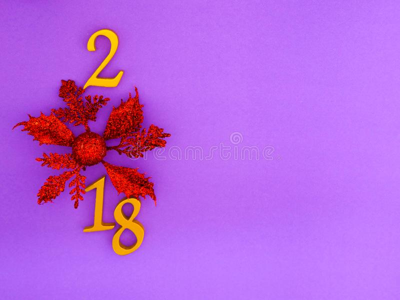 New Year 2018 Banner. A new year 2018 number in gold with red poinsettia on bright violet background royalty free stock image
