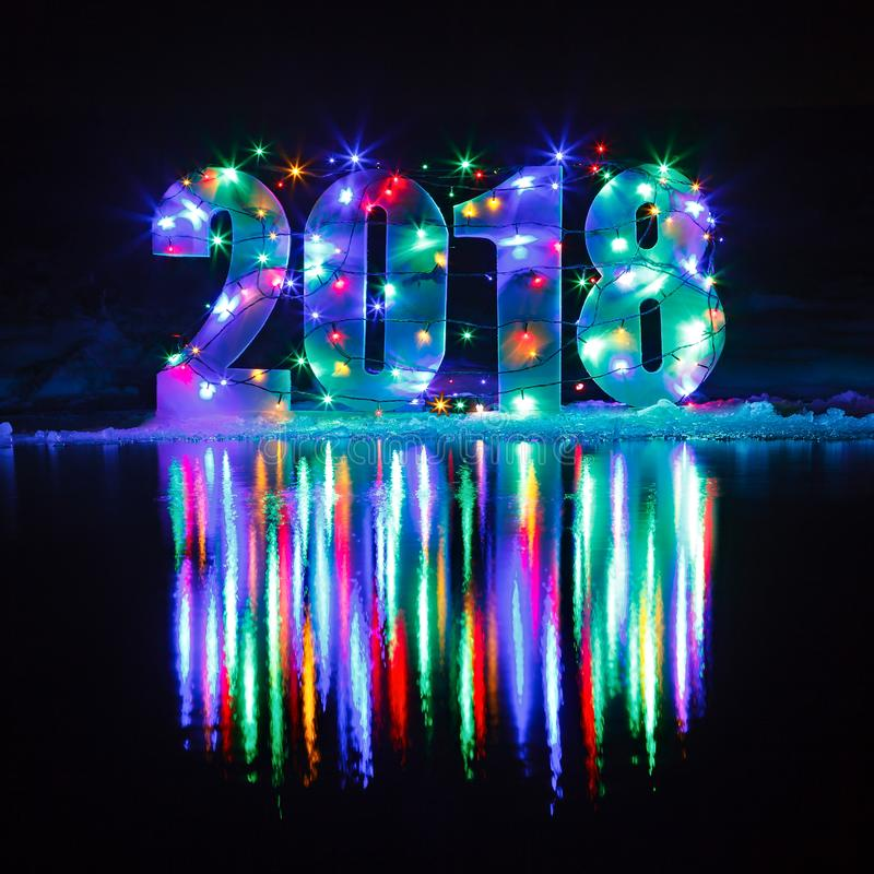 New Year 2018. The number is illuminated by a garland stock photo