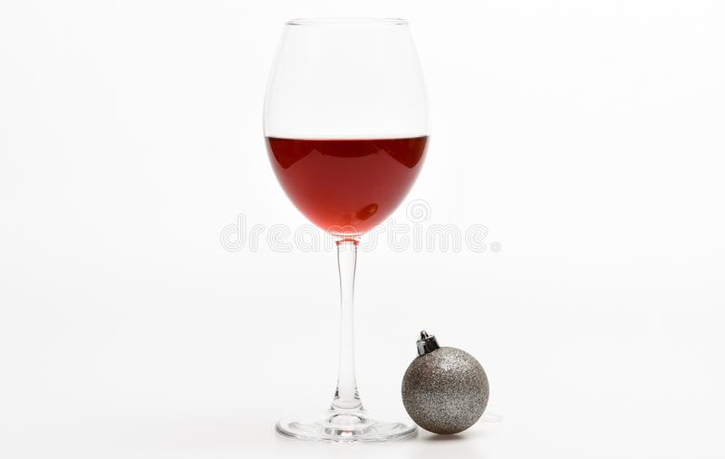 New year party concept. Glass with wine and christmas decoration. Winter celebration with alcohol drink. Wineglass with stock images