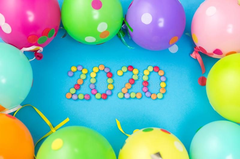 New year 2020 party date with balloons. Holidays, celebration and decoration concept - 2020 new year party date with colorful balloons on blue background royalty free stock image
