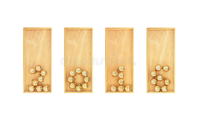New year paved with gold Christmas balls in wooden boxes. Isolated on white background royalty free stock photos