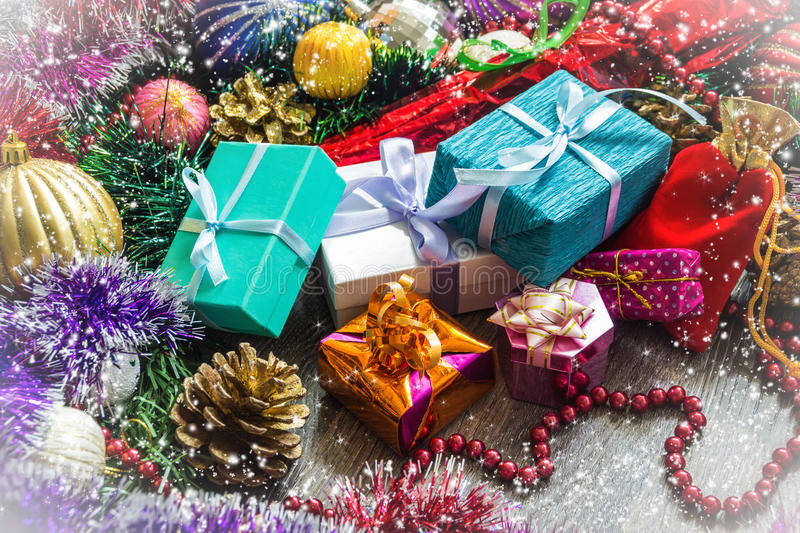 New year picture. Gifts boxes, Christmas decorations, tinsel and beads stock image