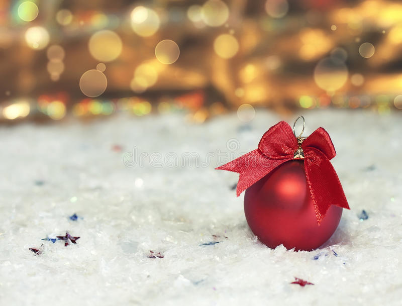 New Year red ball. Lying in the snow royalty free stock images