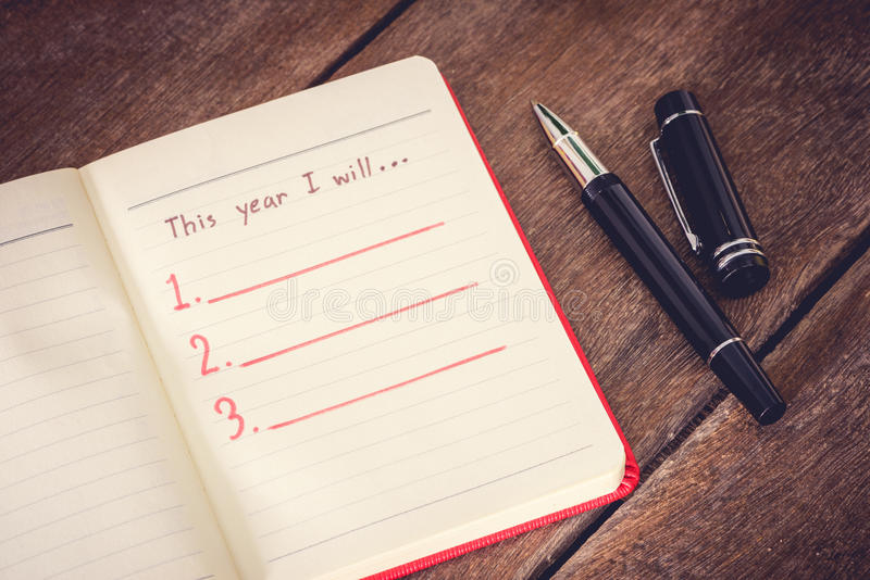 New Year Resolution, Empty list. On wooden table stock photography