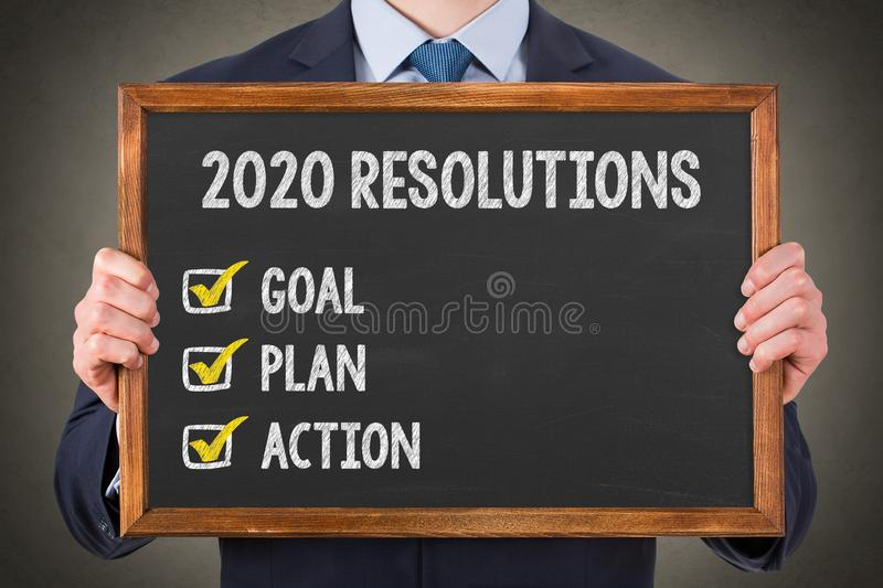 New Year 2020 Resolutions on Chalkboard Background royalty free stock image