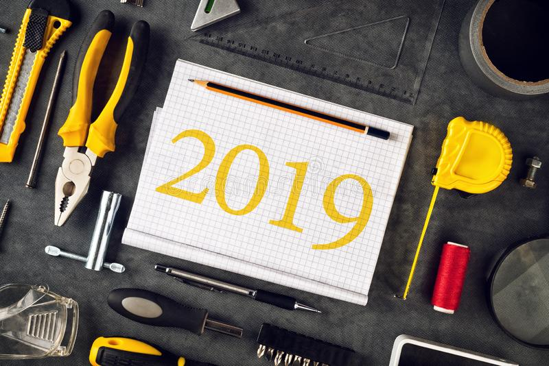 2019 New Year resolutions notebook. With assorted DIY tools royalty free stock photos