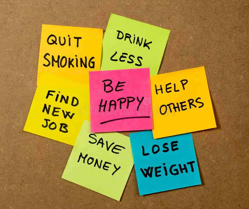 New Year resolutions or popular Goals and colorful sticky post its memo notes on cork board royalty free stock photography