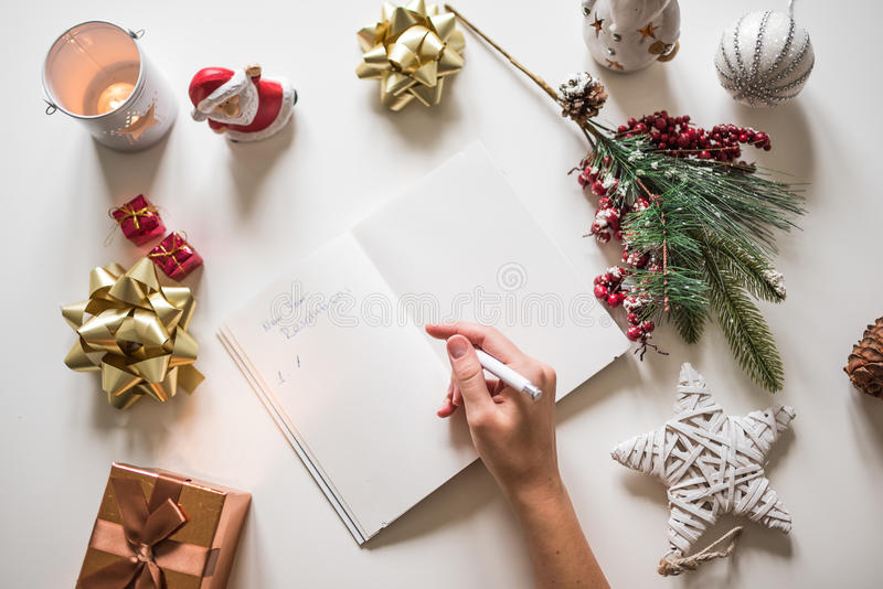 New year resolutions written with a hand on notebook with new years deco retro style stock images