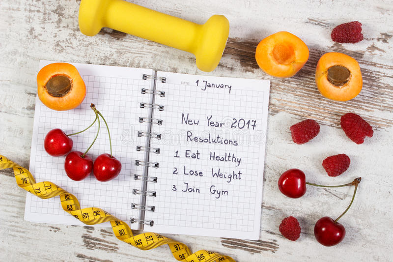 New year resolutions written in notebook on old board stock photos
