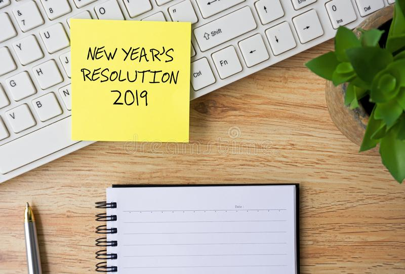 New Year Resolutions 2019. Written on sticky note on Top Of Office desk stock photo