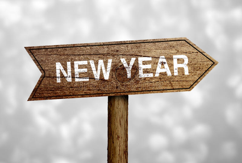 New Year Road Sign. New Year ahead road sign with beautiful bokeh background stock photos