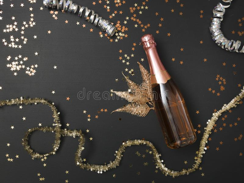 New Year´s background with a bottle of champagne and various New Year`s utensils on royalty free stock images
