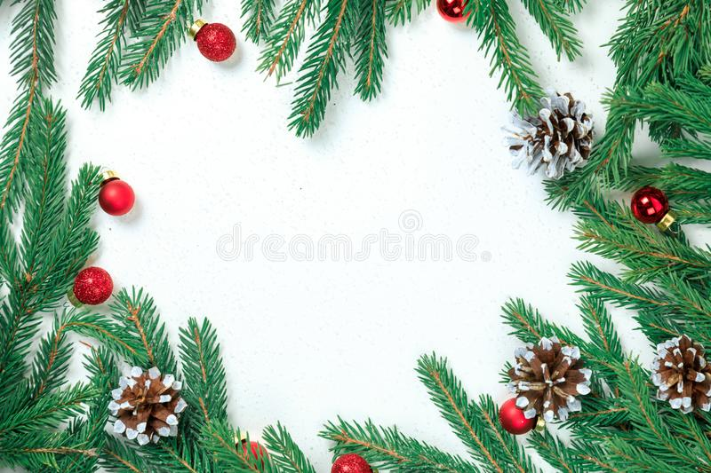 Cristmas background. Christmas jewelry on fir-tree branches, place for inscription. White backgroun stock photos
