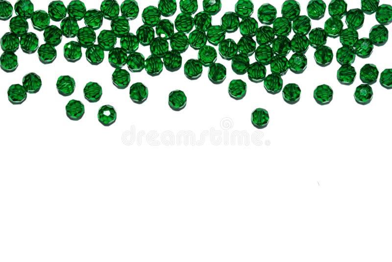 New Year`s border. Christmas decor. Green glass beads. New Year`s border. Christmas decor. Green glass beads royalty free stock photos