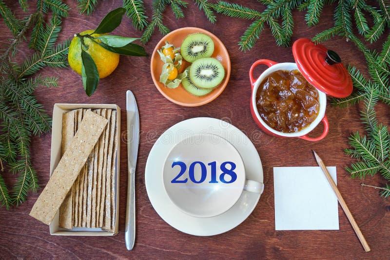New Year`s breakfast, coffee, bread, jam Regolazione festiva della tabella immagini stock libere da diritti