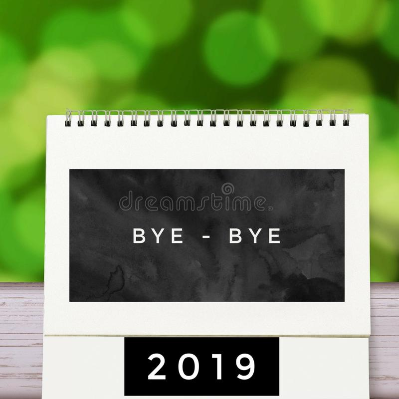 New Year& x27;s card. Green Background with Calendar Concept and text Bye bye 2019 royalty free stock images