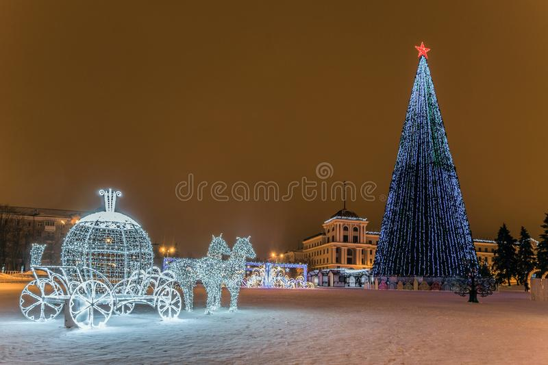 New Year`s Cathedral Square with christmas decorations and lights fir-tree in the center of Belgorod city. LED light horses with a carriage composition stock image