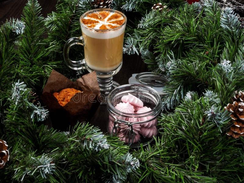 New Year& x27;s and Christmas cake on the table. New Year& x27;s and Christmas cake and coffer on the table. Christmas festive cupcake royalty free stock photos