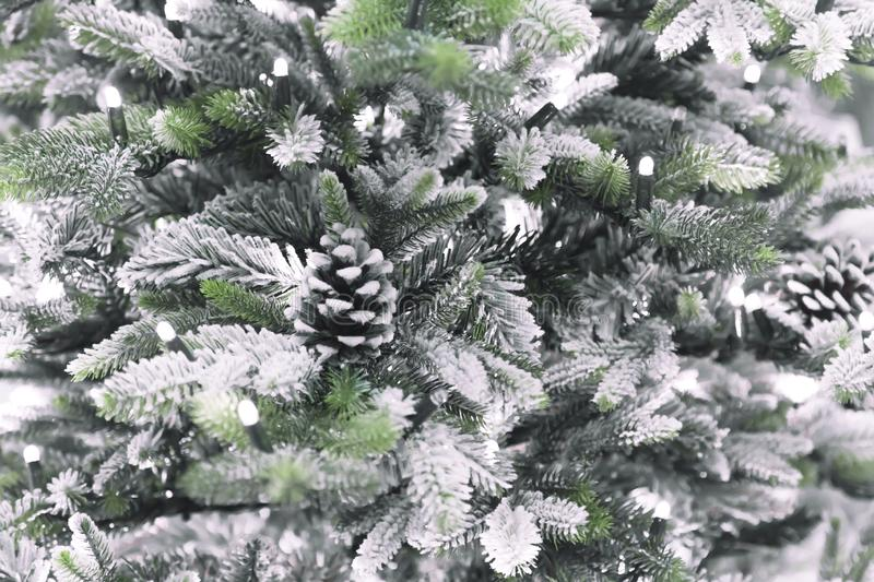 New Year`s and Christmas decor. Festive background with decorative artificial texture of different shining snow-covered branches royalty free stock photography
