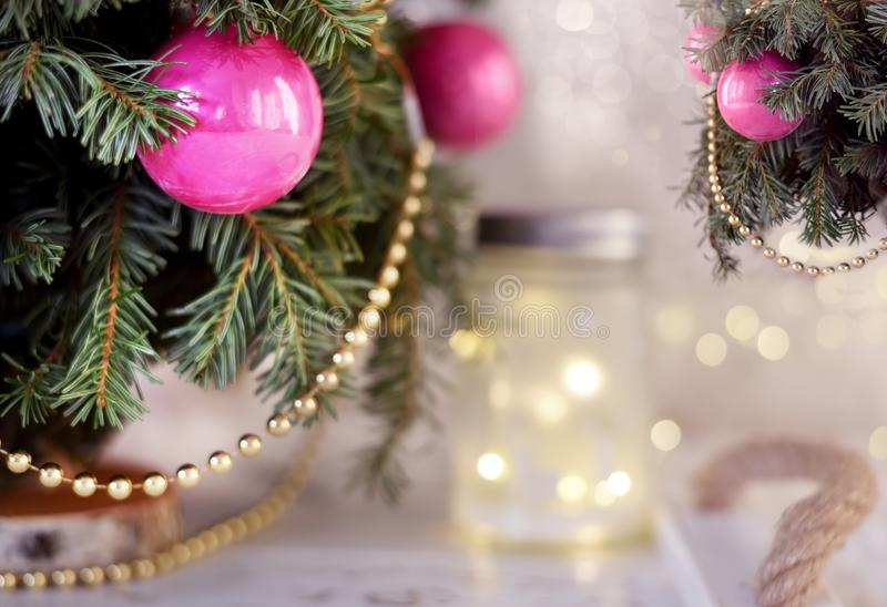 New Year`s Christmas scenery. Christmas tree branches with toys stock images
