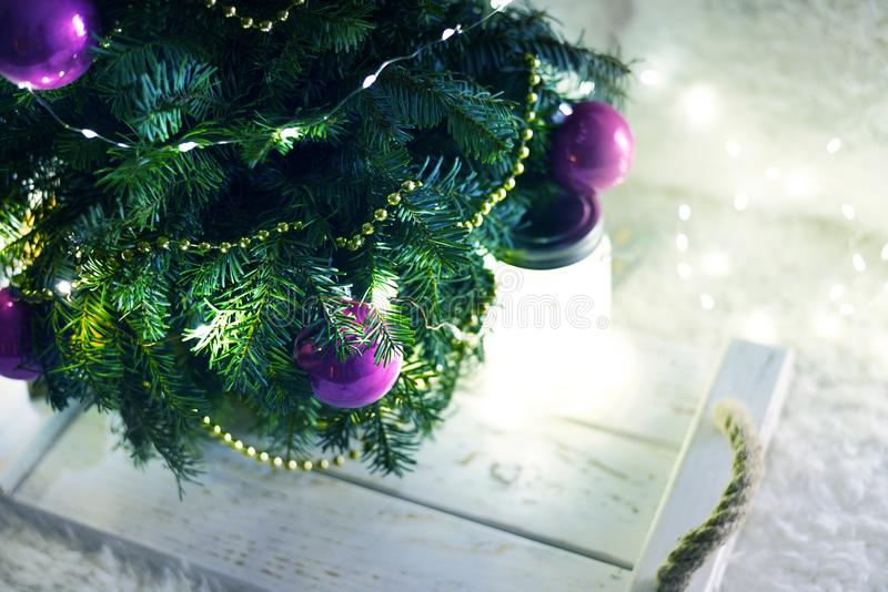 New Year`s Christmas scenery. Christmas tree branches with toys stock image