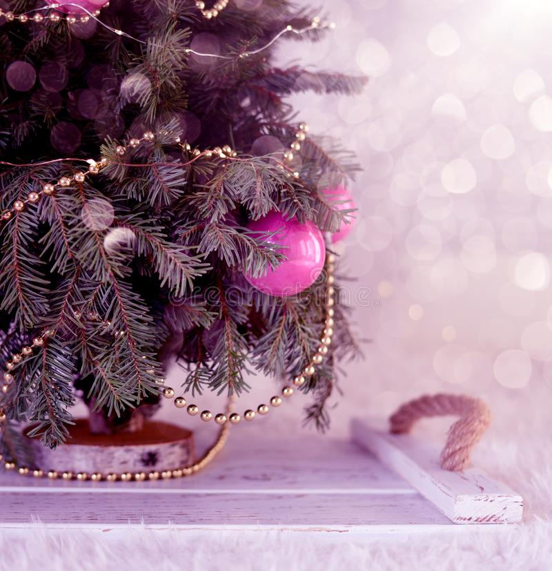 New Year`s Christmas scenery. Christmas tree branches with toys and sparkling lights. stock image