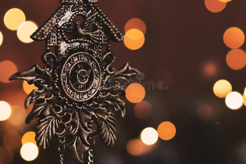 New Year`s clock. Decorated with gift box and decorations background. Celebration Concept for New Year Eve stock image
