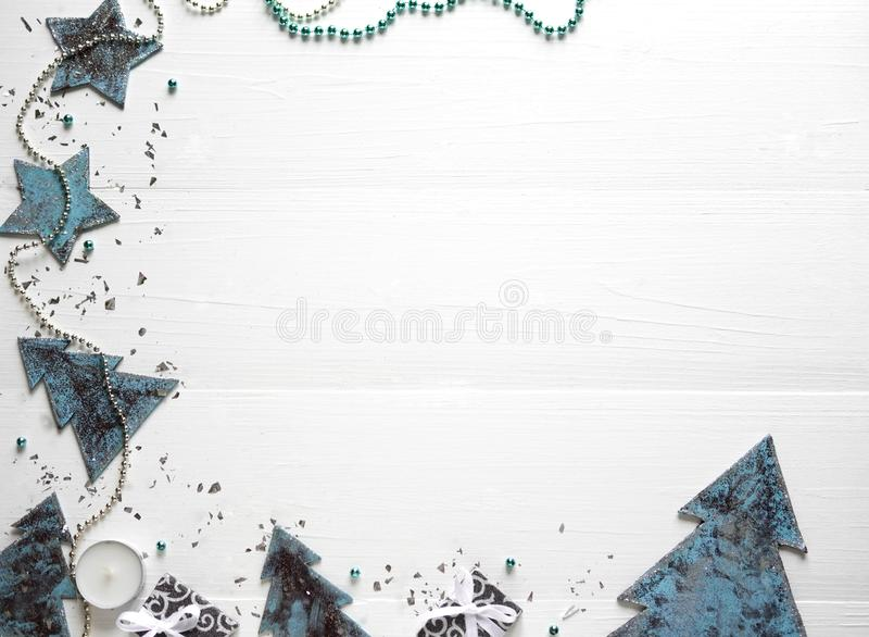 New Year`s composition. Frame for text with Christmas tree and cones on a wooden white background. New Year`s discounts. Christmas Holidays - frame for text stock photography