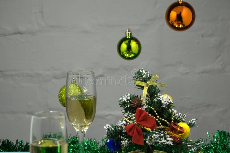 New Year`s composition. New Year champagne glasses, gifts and Christmas tree balls are on the table closeup.  stock image