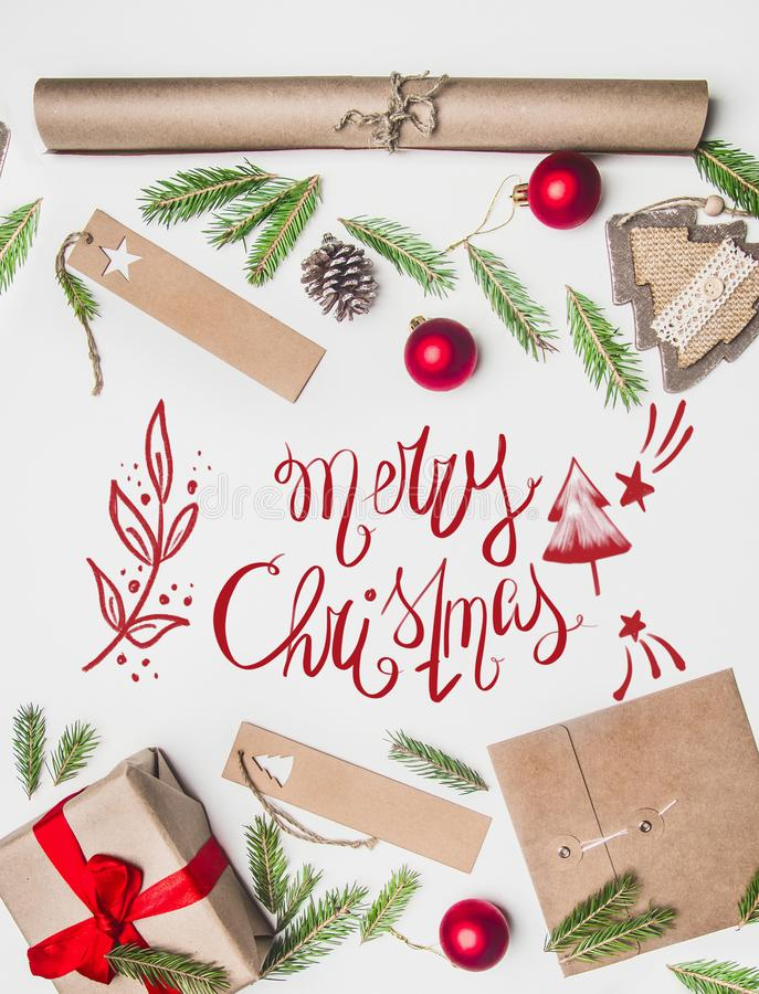 New Year`s concert, wrapped gift, wrapping paper, Christmas tree branches and toys on a white background with the inscription stock photography