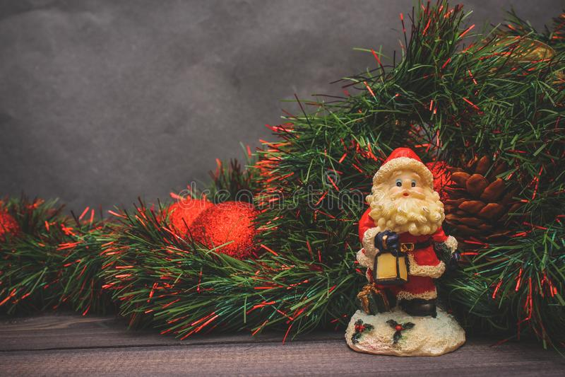 New Year`s decor and festive toys on a wooden table with a red string box with a gift Santa Claus.Happy New Year stock images