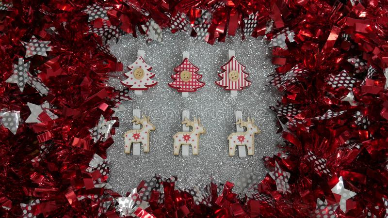 New Year`s decoration. Red and silver Twisted Tinsel Garland as a frame. Silver glitter background stock image