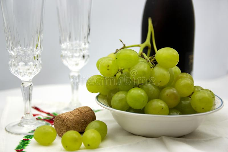 New Year's Eve celebration with lucky grapes and champagne or cava royalty free stock images