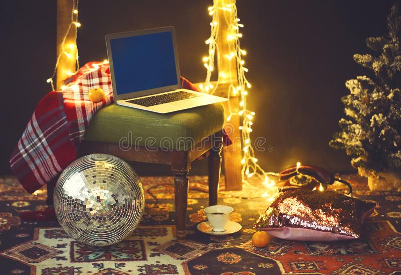 New Year`s eve or Christmas still life with retro phone, disco ball, coffee, candle and blanket stock image