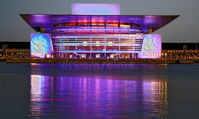 Purple Copenhagen Opera at New Year`s Eve. New year`s Eve in Copenhagen... The Opera changes constantly the lights and it gives this wonderful purple effect royalty free stock photo