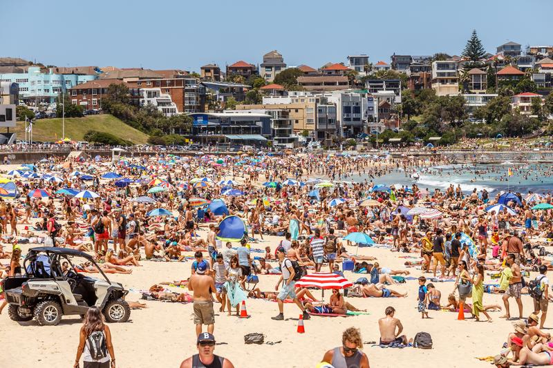 Busy Bondi Beach at New Year`s Eve. Busy summer day at Bondi Beach. Tourists and locals alike are getting ready for Sydney`s New Year`s Eve party