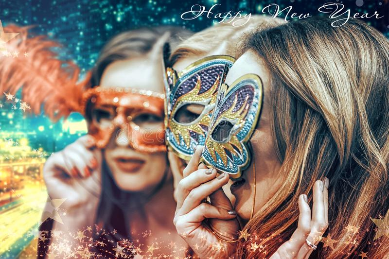 Masquerade - girls in Venetian masks on New Year`s holiday. New Year`s Eve - young girls in masquerade masks royalty free stock image