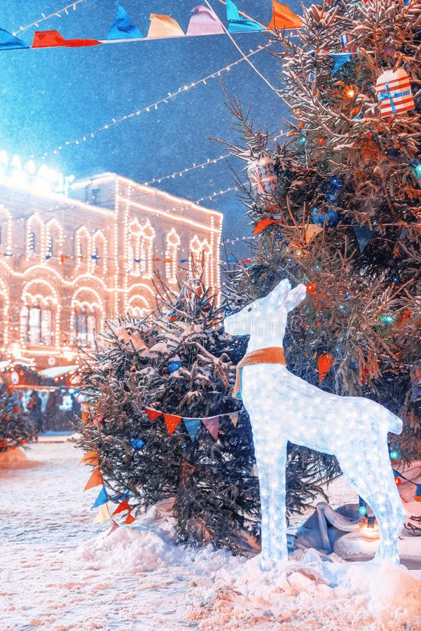 New Year`s Fair on Red Square. New Year`s scenery. Deer of lights. GUM Winter. royalty free stock photos