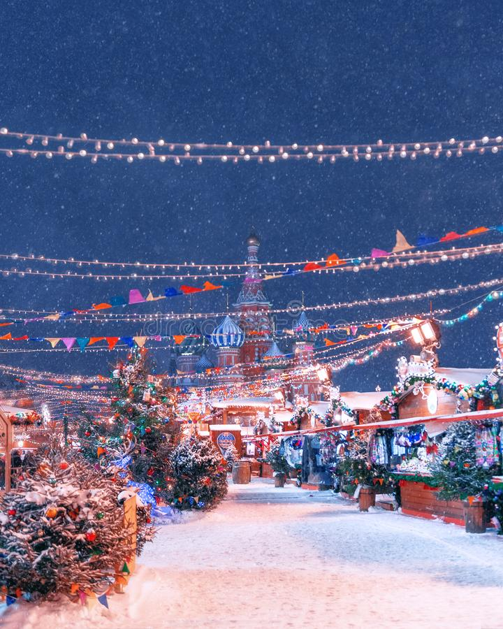 New Year`s Fair on Red Square. St. Basil`s Cathedral. Winter, snow,New Year`s Fair on Red Square. St. Basil`s Cathedral. royalty free stock photo