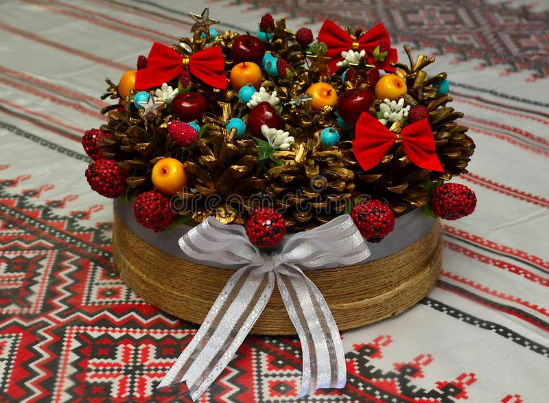 New Year`s, festive still life with cones berries nuts on the table. stock image