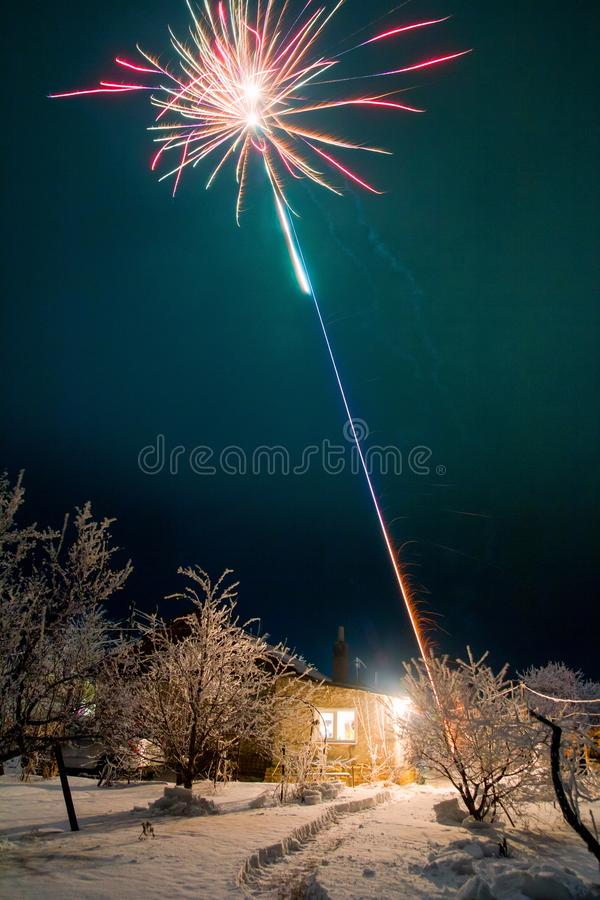 New Year`s fireworks in the yard of a rural house. royalty free stock image