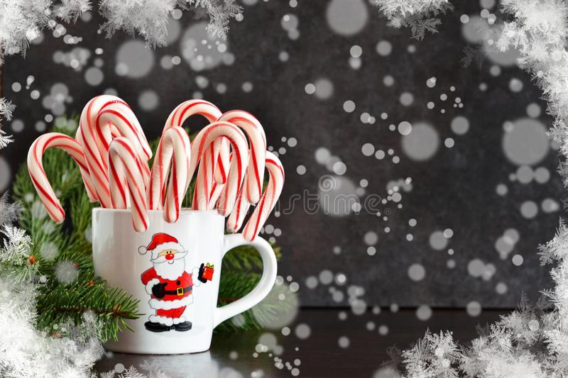 New Year`s food background. Candy canes in a cup royalty free stock image