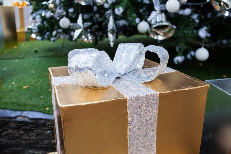 New Year& x27;s gift and decoration, Christmas background, gift box for special day. Abstract, anniversary, beautiful, birthday, bokeh, bow, boxes, celebration royalty free stock image