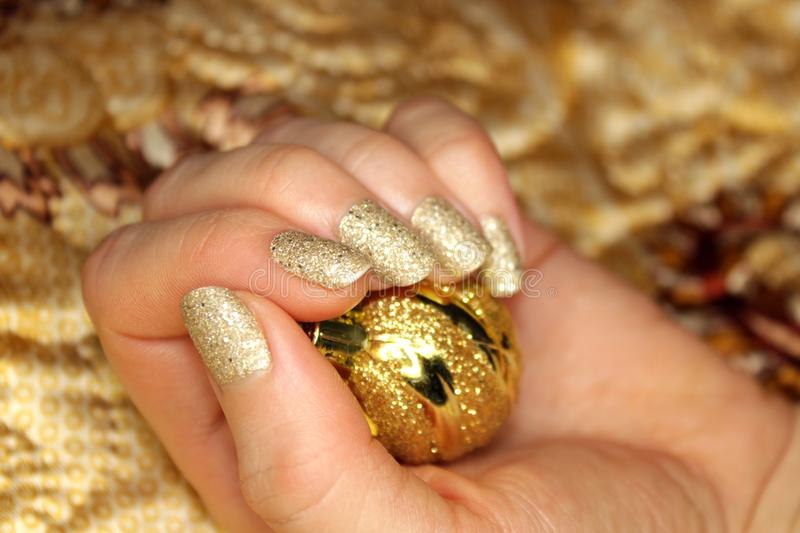 New Year`s golden nail manicure stock photo