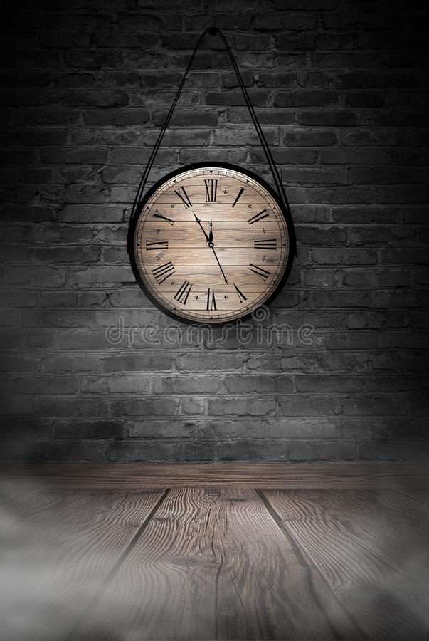 New Year`s Hours. Round wooden clock on the old brick wall, bokeh effect, celebratory, magic light, New Year, Christmas. stock photos