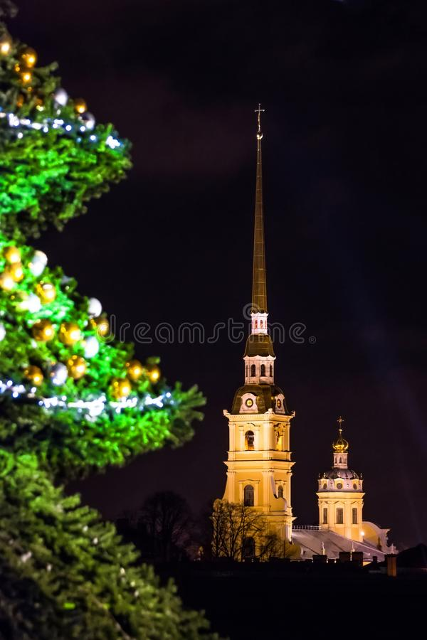 New Year`s landscape with a green decorated Christmas tree St. Petersburg view of the Peter-Pavel`s Fortress. New Year`s landscape with a green decorated stock image